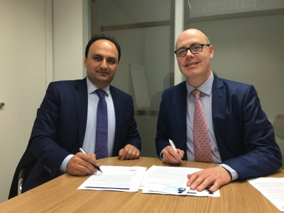 Ali and Matthew sign the agreement to form TVET UK Iran.